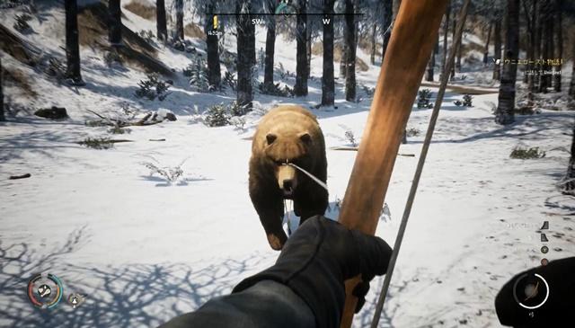 クマを弓矢で射る様子
